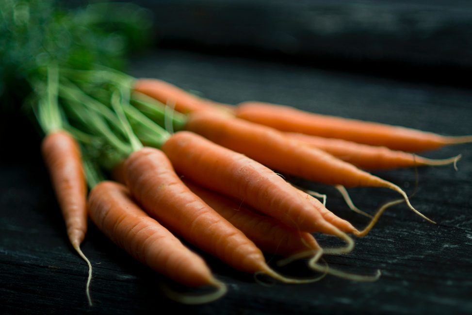 A selective focus photograph of carrots illustrating the best lens for food photography