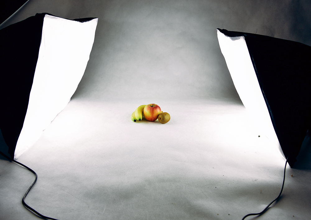 Two softboxes in use by a professional food photographer
