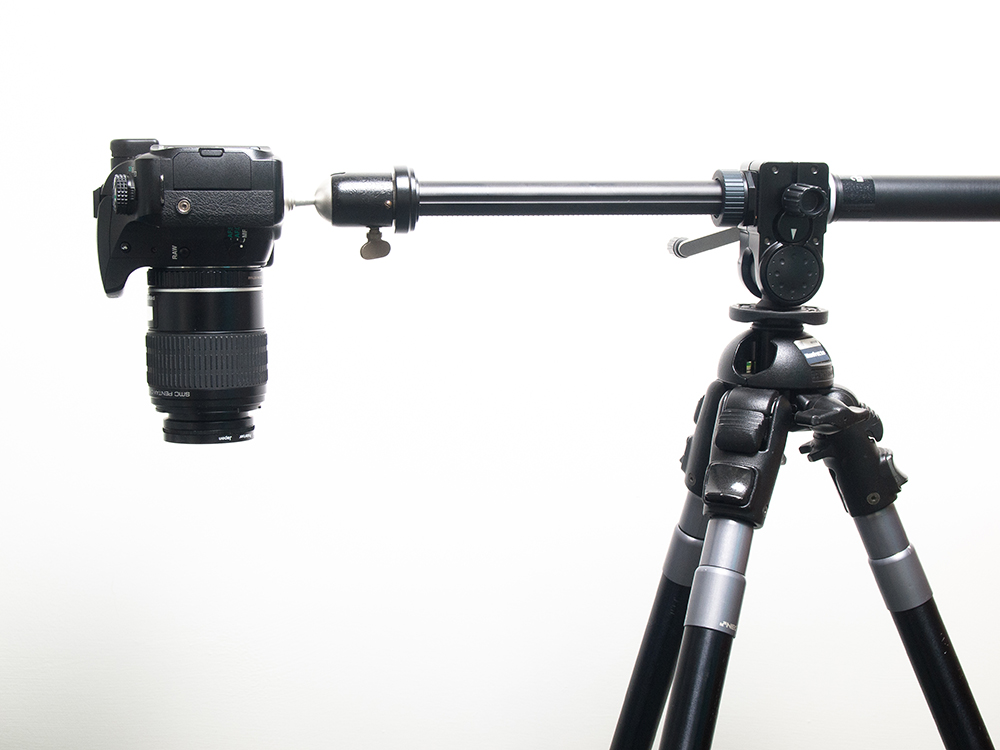A digital camera on a tripod arm, an essential part of every professiona food photographer's food photography equipment