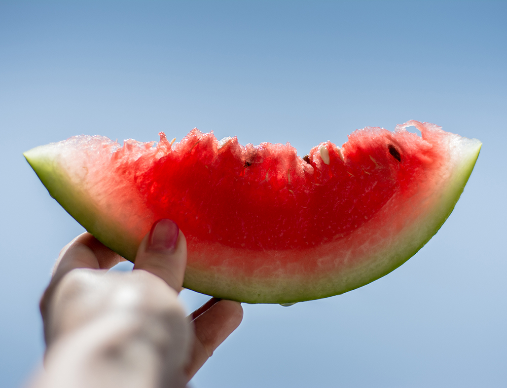 A food photography picture of a watermelon held up the light